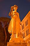 A statue in the Piazza del Popolo at night in Rome, Italy