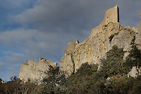 "Buttress of Lower Castle (right) and in the distance, Chapelle San Jordi (left) and High Castle (right), Peyrepertuse Castle or Chateau Pierre Pertuse, Cathar Castle, Duilhac-sous-Peyrepertuse, Corbieres, Aude, France. This castle consists of a Lower Castle built by the Kings of Aragon in the 11th century and a High Castle built by Louis IX in the 13th century, joined by a huge staircase. Its name means pierced rock in Occitan and it has been associated with the Counts of Narbonne and Barcelona. It is one of the ""Five Sons of Carcassonne"" or ""cinq fils de Carcassonne"" and is a listed monument historique. Picture by Manuel Cohen"