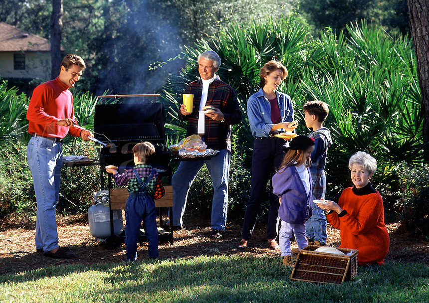 A three generation family barbeque picnic.