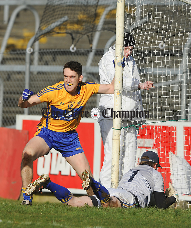 Shane Brennan of Clare celebrates after scoring a goal against Robert Lambert of Wicklow during their National League division 4 round 4 game at Cusack Park. Photograph by John Kelly.