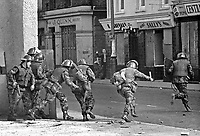 British military snatch squad in operation in William Street, Londonderry, N Ireland, UK during the Battle of the Bogside in August 1969. 19690800222.<br />