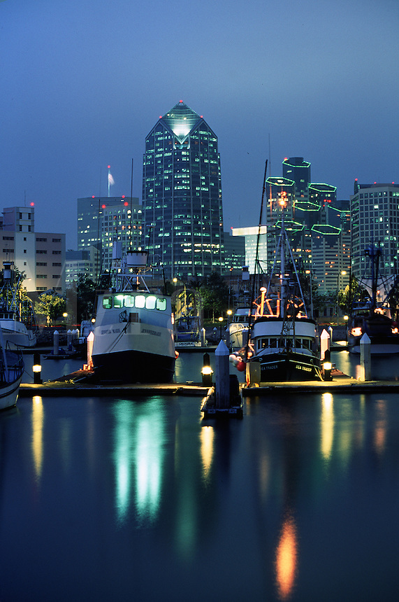 The San Diego skyline at dusk with fishing boats in the harbour. San Diego, California.