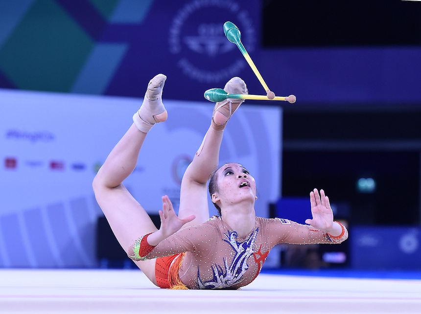 Malaysia's Wong Pog San competes in rhythmic gymnastics team final and individual qualification subdivision 2<br /> <br /> Photographer Chris Vaughan/CameraSport<br /> <br /> 20th Commonwealth Games - Day 1 - Thursday 24th July 2014 - Rhythmic Gymnastics - The SSE Hydro - Glasgow - UK<br /> <br /> &copy; CameraSport - 43 Linden Ave. Countesthorpe. Leicester. England. LE8 5PG - Tel: +44 (0) 116 277 4147 - admin@camerasport.com - www.camerasport.com