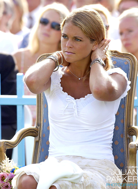 CONCERT IN BERGHOLM TO CELEBRATE CROWN PRINCESS VICTORIA.OF SWEDEN'S 25TH BIRTHDAY.  14/7/02 . PICTURE: UK PRESS  (ref 5105-34).PRINCESS MADELEINE OF SWEDEN.