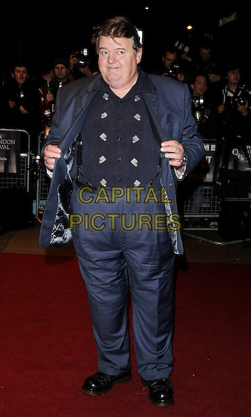 "ROBBIE COLTRANE .At ""The Brothers Bloom"" UK Premiere during the London Film Festival, Odeon West end, London, England, .October 27th 2008..full length blue suit shirt holding jacket open .CAP/CAN.©Can Nguyen/Capital Pictures"