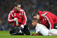 Wayne Routledge receives attention as he feels the pain from a knock during the Barclays Premier League Match between Manchester City and Swansea City played at the Etihad Stadium, Manchester on 12th December 2015