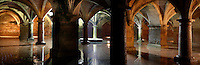 "Panoramic view of Manueline Cistern of the El Jadida (Mazagan) fortress, built by Francisco and Diogo de Arruda, 16th century, El Jadida, Morocco. El Jadida, previously known as Mazagan (Portuguese: Mazag""o), was seized in 1502 by the Portuguese, and they controlled this city until 1769. The underground Cistern was originally designed to store munitions. It served as a fencing school before being used after completion of the town walls in 1541 as a tank to store water. The symmetrical construction has a vaulted roof supported by 25 circular and rectangular pillars, with just one central window in the ceiling, 3.5 m in diameter, producing a single shaft of light. The shallow sheet of water produces a shimmering reflection of the vaulted ceiling in the light. Picture by Manuel Cohen"