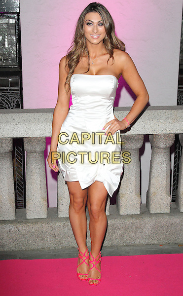 Luisa Zissman<br /> The Inspiration Awards For Women 2013, Cadogan Hall, Sloane Terrace, London, England.<br /> October 2nd, 2013<br /> full length hand on hip white strapless dress pink strappy sandals shoes <br /> CAP/ROS<br /> &copy;Steve Ross/Capital Pictures