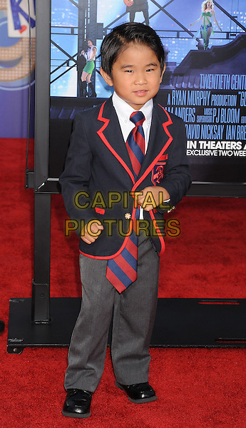"""Kellan Sarmiento.arriving at the Los Angeles Premiere of """"Glee: The 3D Concert Movie"""" at the Regency Village Theatre in Westwood, California, USA, August 6th, 2011..full length  blazer red trim jacket tie striped navy blue suit .CAP/ROT/TM.©TM/Roth Stock/Capital Pictures"""