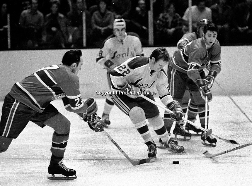 Seals Dennis Hextall, Montreal Canadiens Bob Murdoch and Phil Roberto..(1971 photo/Ron Riesterer)