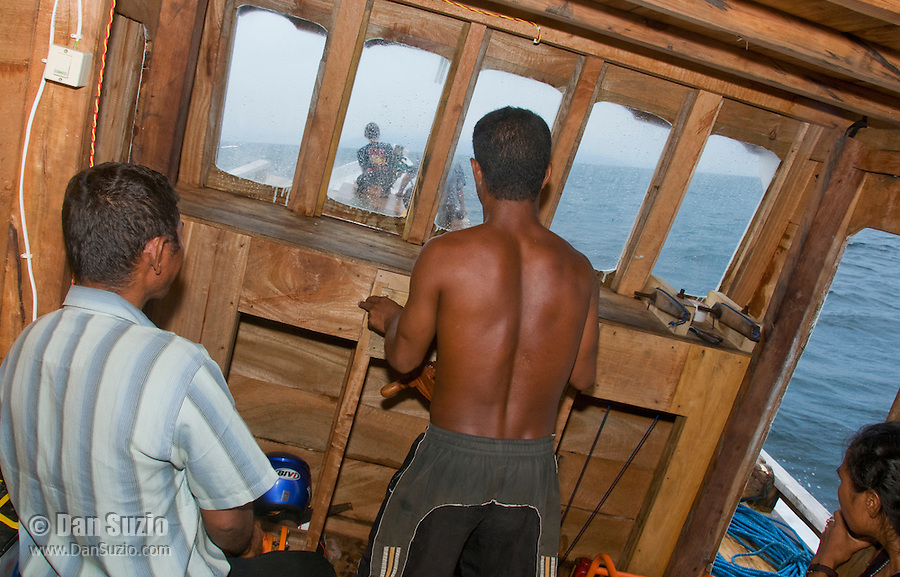 Crew in the cabin of a passenger boat crossing the Wetar Strait from Dili to Atauro Island, Timor-Leste (East Timor)