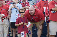 NWA Democrat-Gazette/CHARLIE KAIJO Paxton Smith of Hot Springs and Ron Wilson of Southaven, Miss. (from left) watch players warm up before a football game, Saturday, September 7, 2019 at Vaught-Hemingway Stadium in Oxford, Miss.
