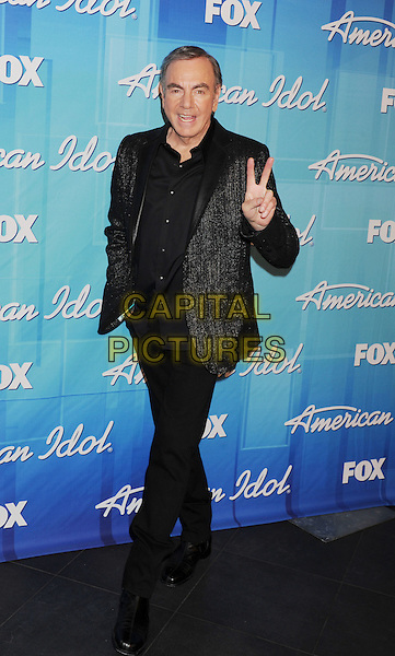 "Neil Diamond.Press room during ""American Idol Season 11 Grand Finale"" Show at Nokia Theatre L.A. Live in Los Angeles, California, USA..May 23rd, 2012 .full length black suit hand v peace sign.CAP/ROT/TM.©Tony Michaels/Roth Stock/Capital Pictures"