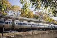 An Amtrak passenger train barrels down the Hudson tracks through Riverside Park in New York on its way to Penn Station on Sunday, October 27, 2013.  (© Richard B. Levine)