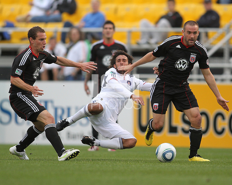 Kurt Mosink)#6 and Branden Barklage#24 of D.C. United knock Gaston Puerari#18 of the Chicago Fire out of the play during a second round match of the Carolina Challenge on March 9 2011 at Blackbaud Stadium, in Charleston, South Carolina. D.C. United won 1-0.