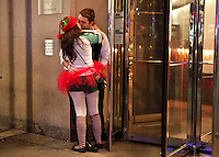 A couple is seen during the SantaCon party in New York, United States. 15/12/2012. Photo by Kena Betancur/VIEWpress.