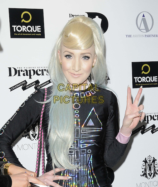 guest (Alexis?).The Drapers Fashion Awards 2012, Grosvenor House Hotel, Park Lane, London, England..November 21st, 2012.half length black silver dress top pattern hand v peace sign.CAP/CAN.©Can Nguyen/Capital Pictures.