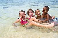Montego Bay, Jamaica. Children  playing together at the Half Moon Resort beach.  Jamaica Tourism.