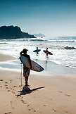 MEXICO, San Pancho, San Francisco, surfers at the water edge at San Pancho Beach