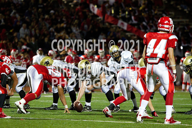 Redondo Beach, CA 10/14/11 - Arthur Fischer (Peninsula #67), Matt Imwalle (Peninsula #17), Joey Augello (Peninsula #58)  in action during the Peninsula vs Redondo Union varsity football game.