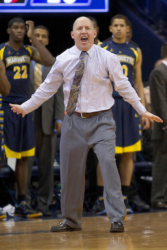 Marquette head coach Buzz Williams shouts out instructions to his team in first half action of NCAA Men's basketball game between Marquette and Notre Dame.  The Notre Dame Fighting Irish defeated the Marquette Golden Eagles 76-59 in game at Purcell Pavilion at the Joyce Center in South Bend, Indiana.