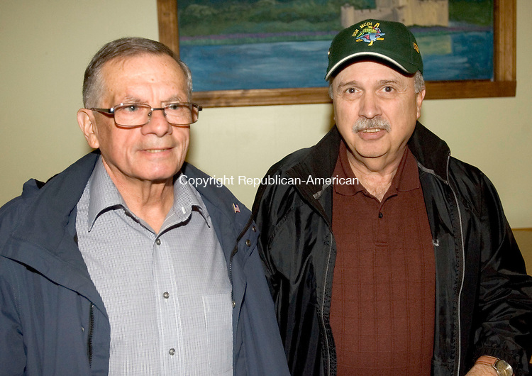 WATERBURY CT. 01 December 2014-120114SV12-From left, Brent LaPrade of Waterbury, retired police, and Mike Thomas of Northfield, retired police, attend the Waterbury Police &amp; Firefighters Retiree Association Christmas Party held at the Ancient Order of Hibernians Club in Waterbury Monday.<br /> Steven Valenti Republican-American