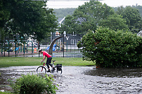 Water floods the intersection of Orchard Street and Beech Street after a severe thunderstorm  in Belmont, Massachusetts, USA, on Wed., July 17, 2019.