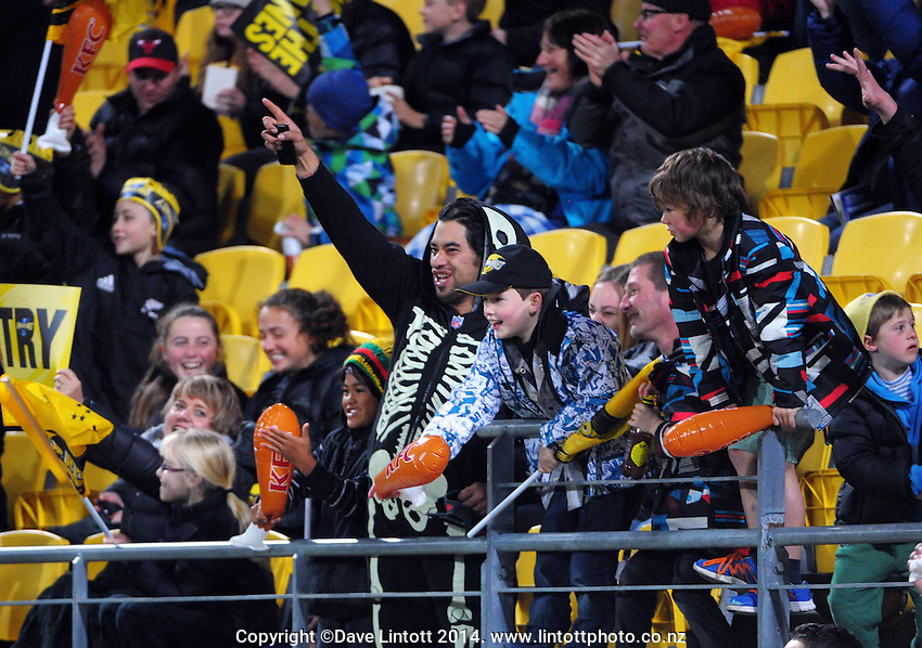 Fans celebrate Blade Thomson's first try during the Super Rugby match between the Hurricanes and Crusaders at Westpac Stadium, Wellington, New Zealand on Saturday, 28 June 2014. Photo: Dave Lintott / lintottphoto.co.nz