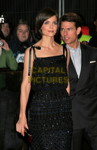 "KATIE HOLMES & TOM CRUISE.At the UK Film Premiere of ""Valkyrie"", Odeon Leicester Square, London, England, January 21st 2009..half length grey gray suit jacket blue black dress beaded navy husband wife Escada ribbon tied shoulder straps .CAP/AH.©Adam Houghton/Capital Pictures"