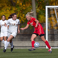 Marist College defender Marissa Mertens (13) passes the ball as Boston College midfielder Patrice Vettori (18) closes. Boston College defeated Marist College, 6-1, in NCAA tournament play at Newton Campus Field, November 13, 2011.