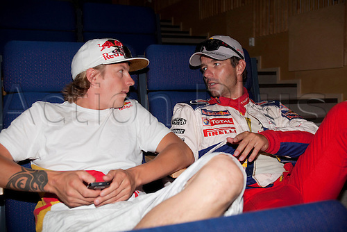 JYVASKYLA, FINLAND - JULY 29: Kimi Raikkonen of Finland (L) and Sebastien Loeb of France (R) waiting for FIA's press conference to start in the WRC Rally Finland on July 29, 2010 in Jyvaskyla, Finland.