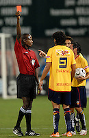 Referee Courtney Campell gives a red card to Monarcas Morelia Luis Landin (9) after pushing DC United defender Bobby Boswell (32) in the back after a foul.  Monarcas Morelia tied DC United 1-1 in  the SuperLiga opening match of the group B, at RFK Stadium Washington DC, Wednesday July 26, 2007.