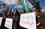 Palestinian members of National and Islamic forces hold banners and Palestine flags during a protest to show solidarity with the martyrs in the West Bank, in Gaza City on December 13, 2018. Israeli forces also killed two Palestinians who were attack suspects. Photo by Mahmoud Ajjour