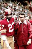Washington Redskins free safety Ken Houston (27) and head coach George Allen, both members of the NFL Hall of Fame are pictures in this undated photo on the sidelines during a game at RFK Stadium in Washington, D.C..Credit: Arnie Sachs / CNP