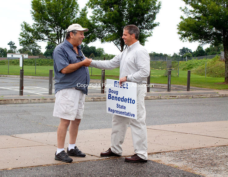 TORRINGTON CT-AUGUST 14 2011 -081412DA03- The Democratic primary for the 63rd House District candidate Douglas J. Benedetto talks with Eugene Milici just before Milici places his vote at Torrington Middle School during the primary election on Tuesday..Darlene Douty Republican-American