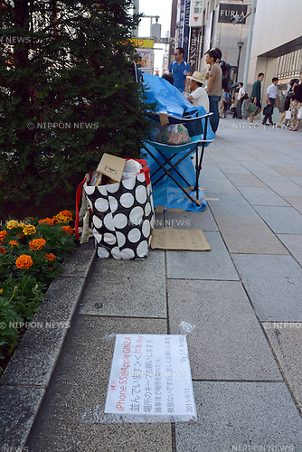 "September 12, 2013, Tokyo, Japan - A notice taped on the sidewalk tells ""I'm the 10th in the line, I'm not here at night, but please don't steal my place!"" as a small group of hard-core Apple lovers have started camping out in front of the Apple Store in Tokyo's bustling Ginza shopping district on Thursday, September 12, more than a week before the scheduled launch of iPhone 5s and lower-cost iPhone 5c. Apple announced the new mobile phones will be available in stores in Japan, U.S. and seven other countries on September 20.  (Photo by Natsuki Sakai/AFLO)"