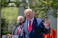 United States President Donald J. Trump speaks at a National Day of Prayer event in the Rose Garden at the White House in Washington, DC on May 3, 2018. Credit: Alex Edelman / CNP /MediaPunch