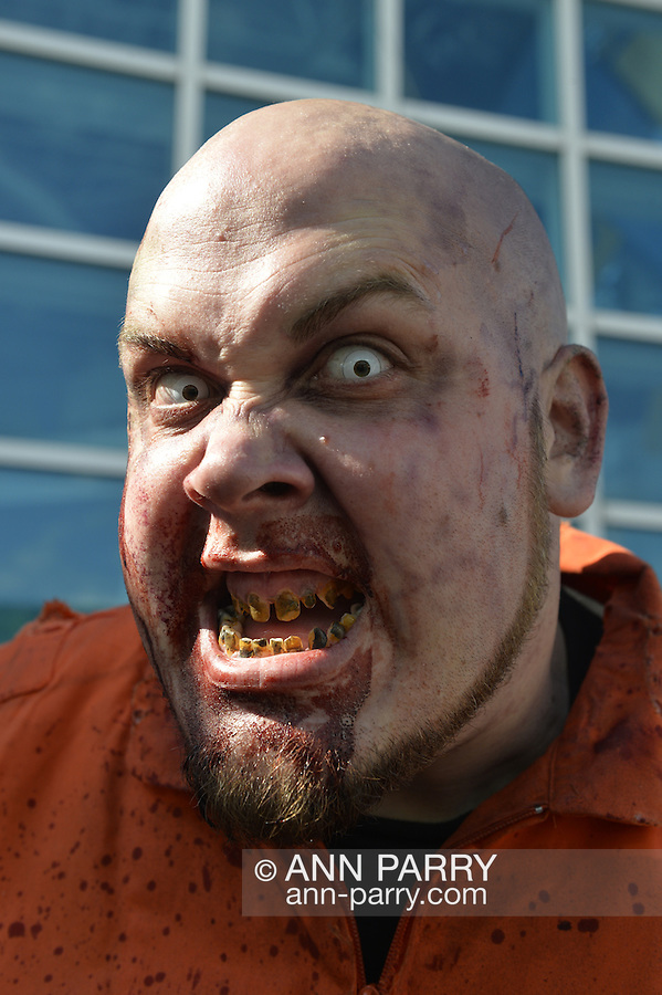 Garden City, New York, U.S. - June 14, 2014 - A zombie from NYZ Apocalypse is at Eternal Con, the annual Pop Culture Expo, with costumes, Comic Books, Collectibles, Gaming, Sci-Fi, Cosplay, Horror, and held at the Cradle of Aviation Museum on Long Island.