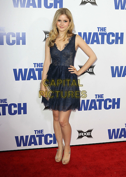 Erin Moriarty.The L.A. Premiere of 'The Watch' held at The Grauman's Chinese Theatre in Hollywood, California, USA..July 23rd, 2012.full length dress hand on hip clutch bag gold beige shoes blue lace .CAP/ADM/KB.©Kevan Brooks/AdMedia/Capital Pictures.