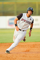 Rangel Ravelo #22 of the Kannapolis Intimidators hustles towards third base against the Delmarva Shorebirds at Fieldcrest Cannon Stadium on August 7, 2011 in Kannapolis, North Carolina.  The Intimidators defeated the Shorebirds 8-3.   (Brian Westerholt / Four Seam Images)