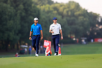 Rory McIlroy (NIR) and  Xander Schauffele (USA) walking down the 9th during round 1 at the WGC HSBC Champions, Sheshan Golf Club, Shanghai, China. 31/10/2019.<br /> Picture Fran Caffrey / Golffile.ie<br /> <br /> All photo usage must carry mandatory copyright credit (© Golffile | Fran Caffrey)