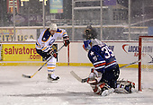 Yuri Khmylev (13) takes a shot on goalie Tom Askey (35) during The Frozen Frontier Buffalo Sabres vs. Rochester Amerks Alumni Game at Frontier Field on December 15, 2013 in Rochester, New York.  (Copyright Mike Janes Photography)