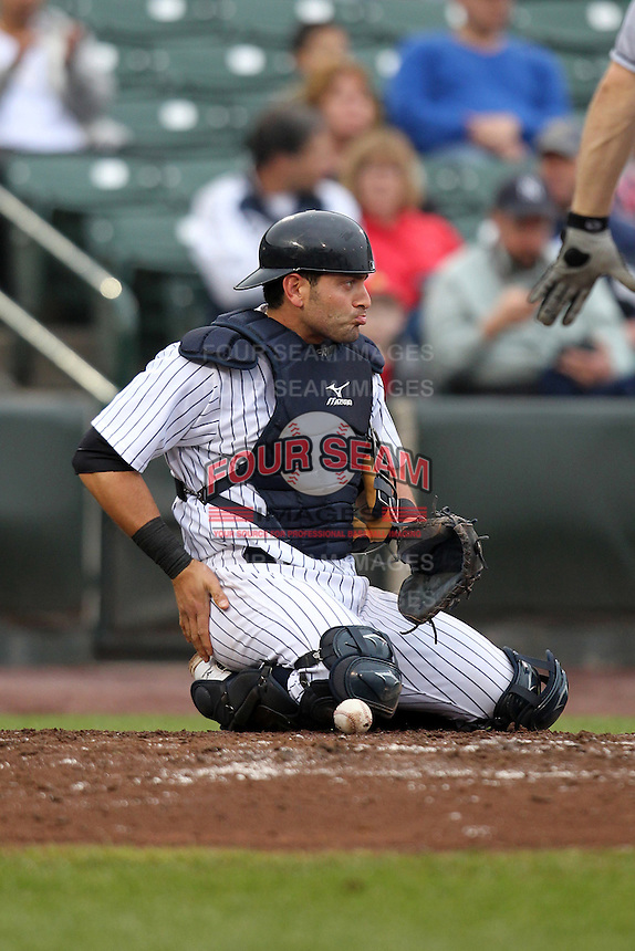 Empire State Yankees catcher Francisco Cervelli #3 looks to the base runners after blocking a ball in the dirt during the first game of a double header against the Columbus Clippers at Frontier Field on May 8, 2012 in Rochester, New York.  Columbus defeated Empire State 1-0.  (Mike Janes/Four Seam Images)