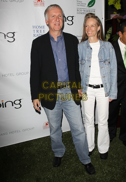 JAMES CAMERON & SUZY AMIS .40th Annivesary of Earth Day held At The JW Marriott LA Live, Los Angeles, California, USA, 22nd April 2010..full length blue shirt black jacket jeans white denim holding hands husband wife couple .CAP/ADM/KB.©Kevan Brooks/AdMedia/Capital Pictures.