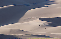 Hikers in the Great Sand Dunes National Park.<br /> <br /> Canon EOS 5D, 70-200 f/2.8L lens