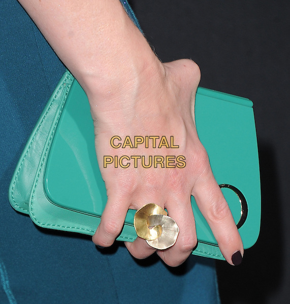 Marley Shelton's hand .attending the Paramount Los Angeles film premiere of 'Hansel and Gretel: Witch Hunters', held at The Grauman's Chinese Theater in Hollywood, California, USA, January 24th 2013..detail green clutch bag hand ring turquoise                                       .CAP/DVS.©Debbie VanStory/Capital Pictures.