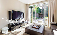 BNPS.co.uk (01202 558833)<br /> Pic: Savills/BNPS<br /> <br /> Paint it white...stylish interior.<br /> <br /> Gimme Shelter ? - Who's Next for this Putney property with a fascinating rock n roll back story.<br /> <br /> An opulent luxury apartment inside a former church hall that hosted the Rolling Stones and The Who has emerged for sale for nearly £2million.<br /> <br /> Hotham Hall in Putney, South West London, dates back to 1913 and was a venue for both bands on the 22nd December 1963 when The Detours, an early incarnation of The Who, supported the Rolling Stones.<br /> <br /> It's even claimed Pete Townshend first created his signature windmilling guitar style here after watching Keith Richards warming up back stage.<br /> <br /> The former hall to St Mary's church also hosted speeches from Winston Churchill in 1933 and Anthony Eden in 1934.<br /> <br /> It has now been converted into luxury apartments being sold off by up-market estate agents Savills with a whopping £2 million asking price.
