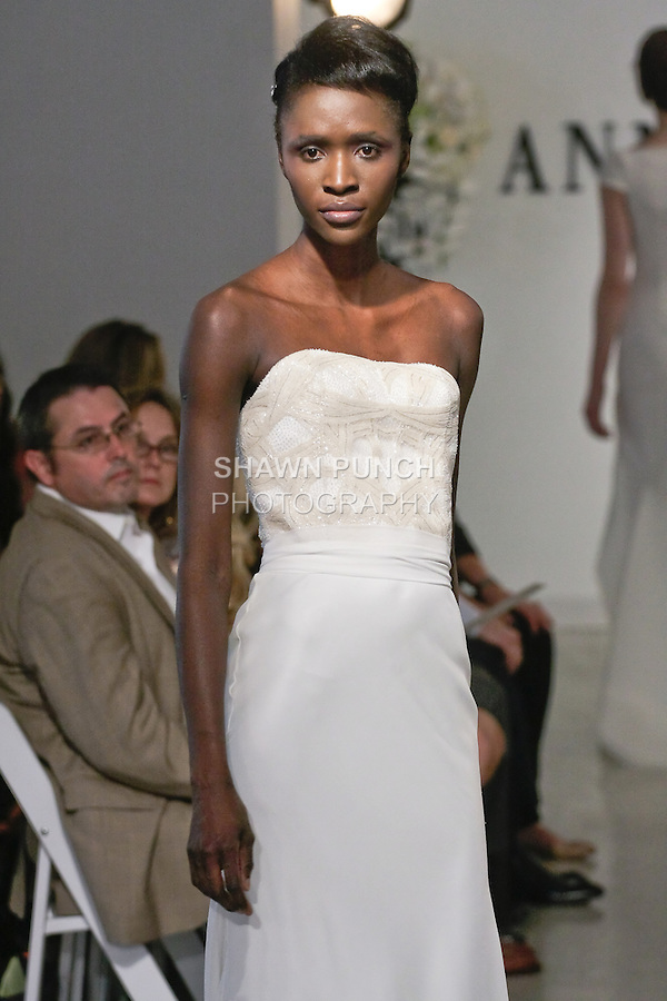 """Model walks runway in a Bridal dress from the Anne Bowen Bridal Spring 2013 """"Coat of Arms"""" collection fashion show, during Bridal Fashion Week New York April 2012."""