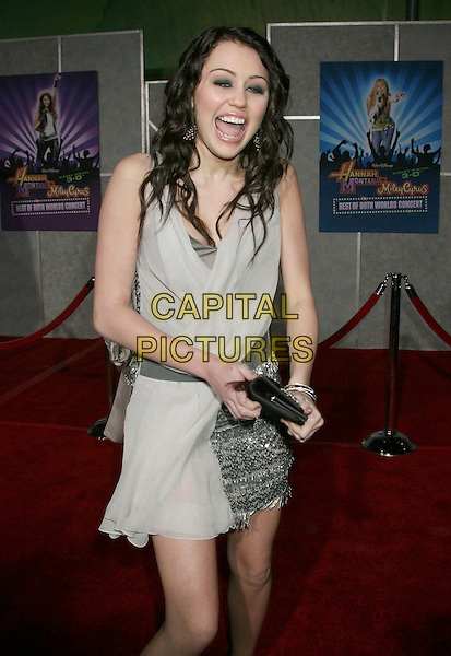 "MILEY CYRUS.Disney's """"Hannah Montana & Miley Cyrus: Best Of Both Worlds"" World Premiere held at the El Capitan Theatre, Hollywood, California, .USA,1 7 January 2008..half length silver grey gray dress black shoes clutch bag sequined.CAP/ADM/RE.©Russ Elliot/AdMedia/Capital Pictures. *** Local Caption *** ."