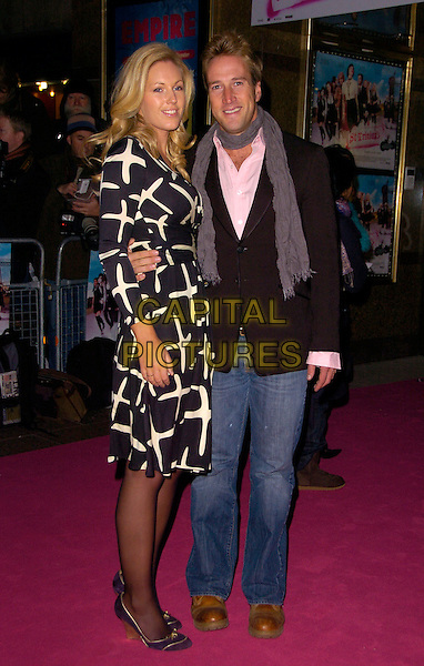 "MARINA HUNT & BEN FOGLE.The UK Film Premiere of ""St. Trinian's"" held at the Empire Leicester Square, London, England..December 10th 2007.full length jacket dress white pattern scarf grey gray jeans denim couple .CAP/CAN.©Can Nguyen/Capital Pictures"